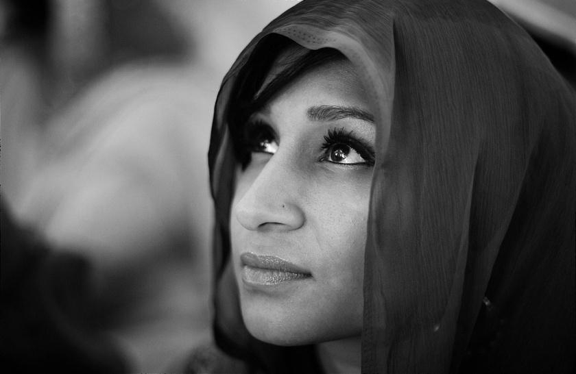 B&W closeup of hooded woman