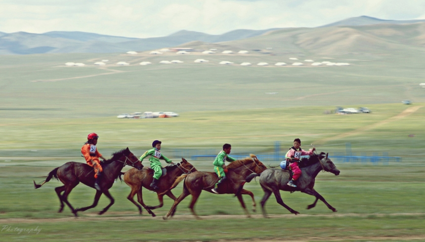 Horseback riders at Naadam Festival