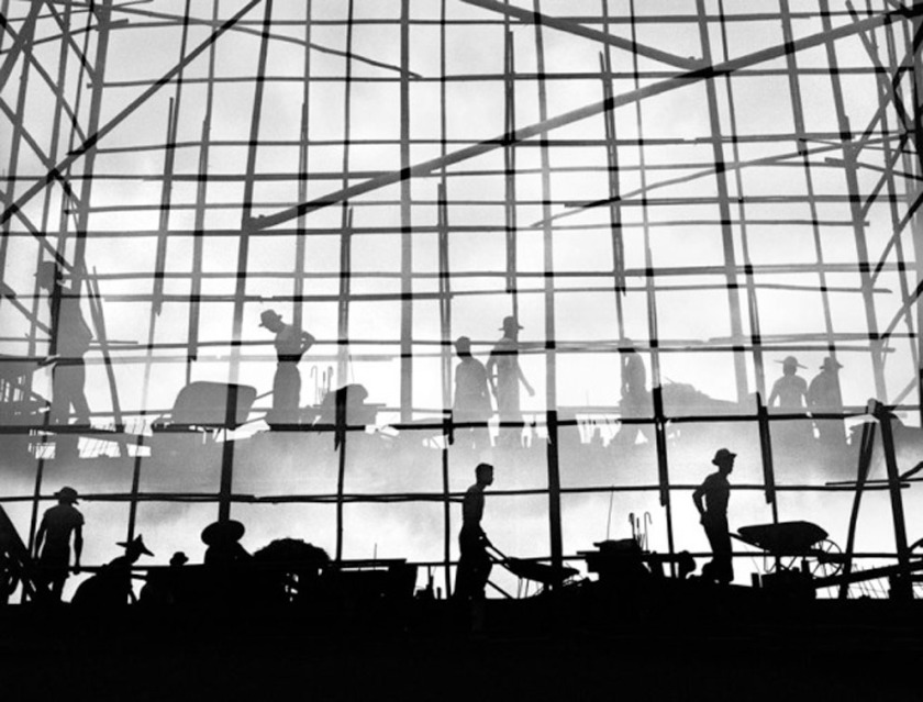 Silhouetted construction workers in Hong Kong