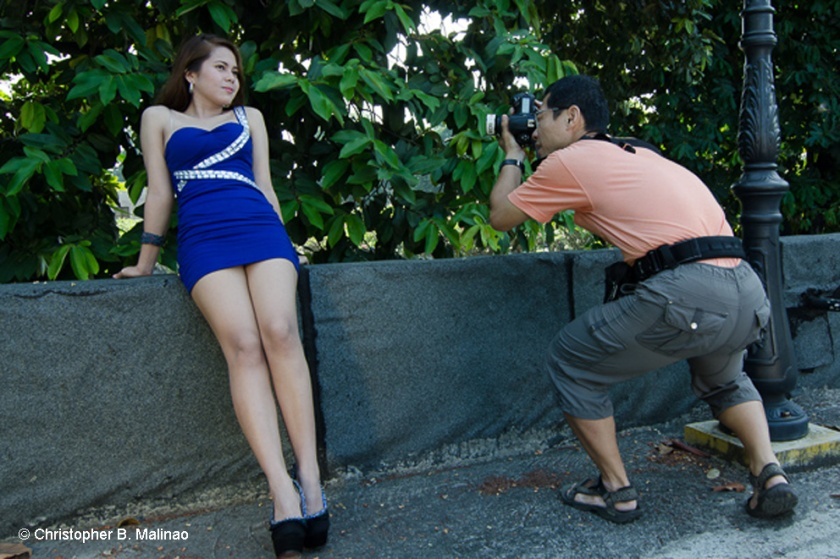 Photographer Lawrence Ang uses his knees to get the best angle