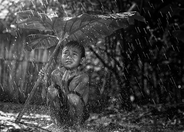 Indonesian boy in the rain