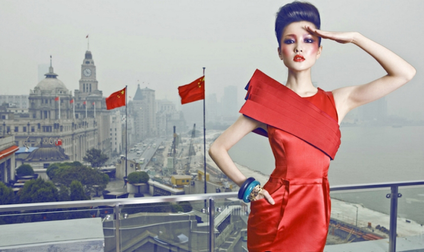 Fashionable Chinese woman in red dress. photo by Chinese photographer Chen Man