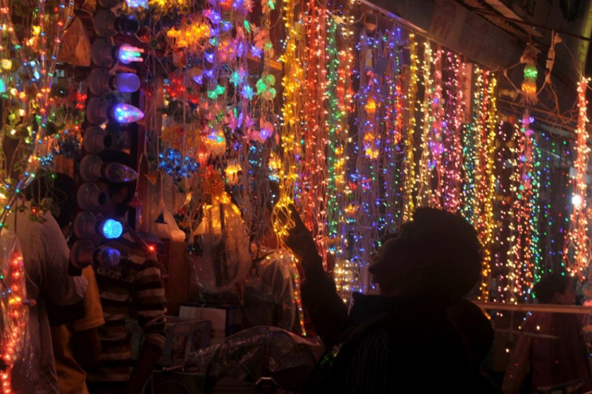 Man shopping for Diwali electric lights