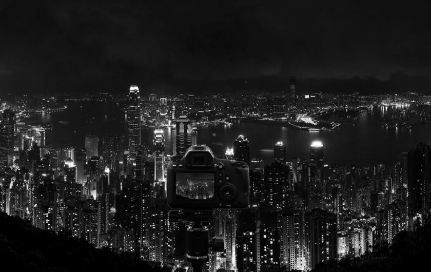 Camera on tripod overlooking Hong Kong