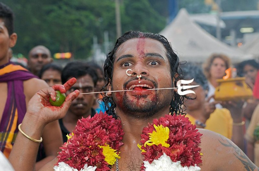 Celebrant at Thaipusam with pierced cheeks