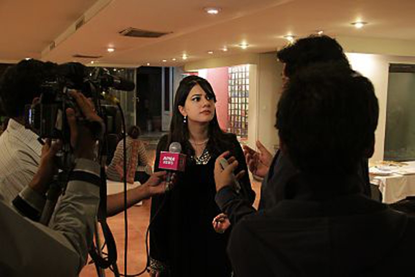 Maryam Arif being interviewed
